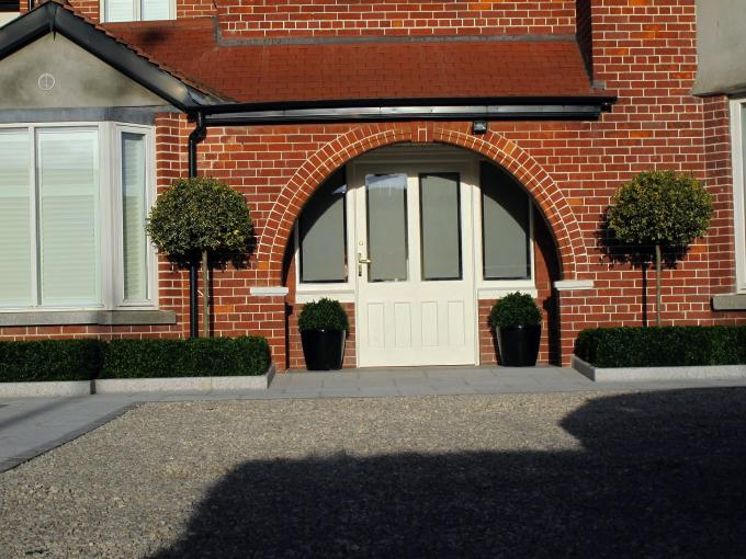 Simple, symmetrical planting providing stunning stylish results - See more at: http://www.owenchubblandscapers.com/blog/granite-driveway-design-landscaping-terenure#sthash.d20gkJbr.dpuf